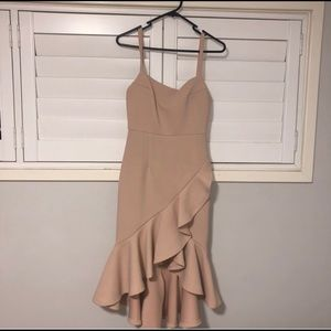 - Stelly peach coloured dress